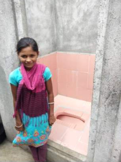 Young indian child happy to have a toilet at home
