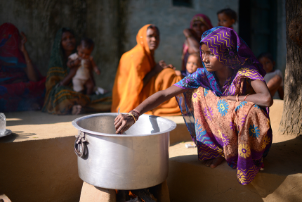 indian woman cooking a meal